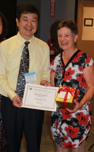 Junyang Zhao receives certificate from Brenda Gallie for delivering the Ellsworth Lecture